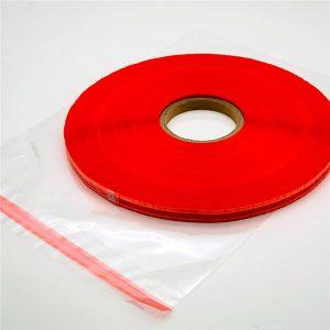Barvni trak za zapiranje vrečke